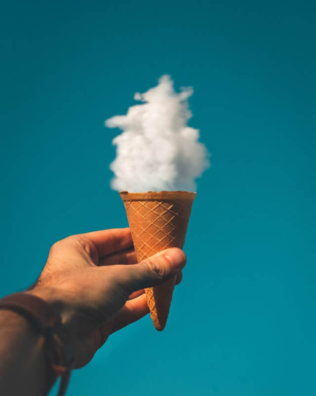 In this example, we remove the turquoise color background from a JPG image of a man holding an ice-cream cone under a cloud.